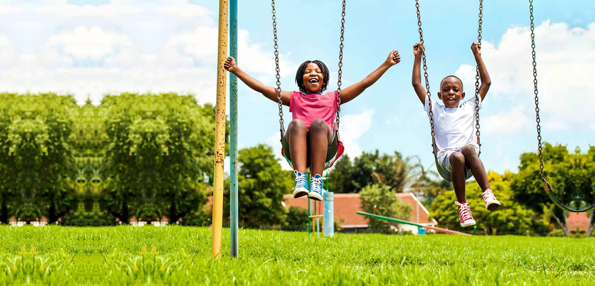kids playing on a swing
